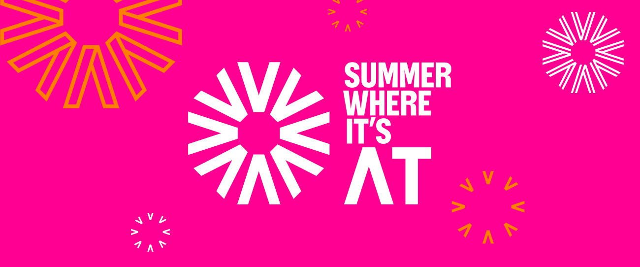 "The ""Summer where it's at"" logo. The text is white and next to a series of white arrows pointing inward on a pink background"