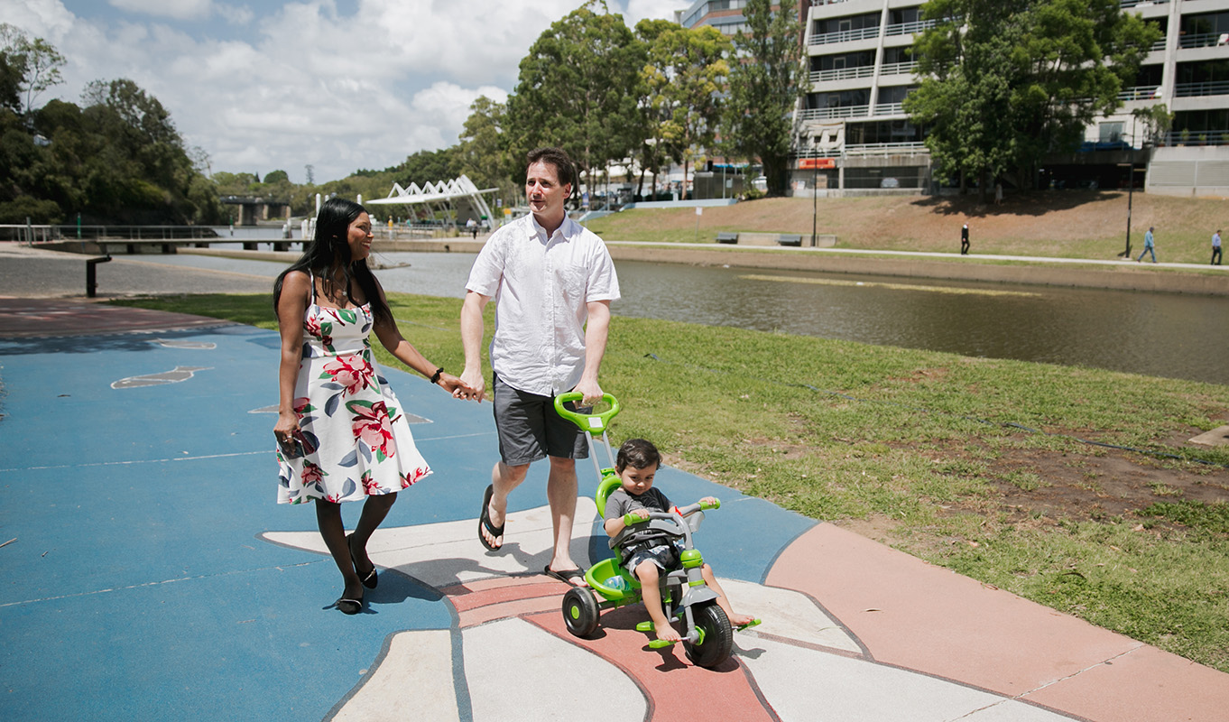 Family walking Parramatta River.