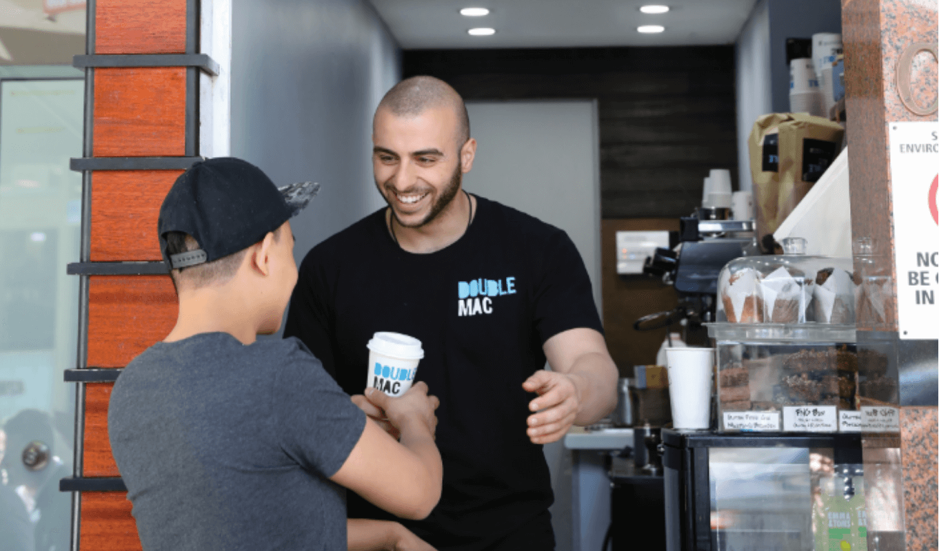 Double Mac Barista Serving Coffee