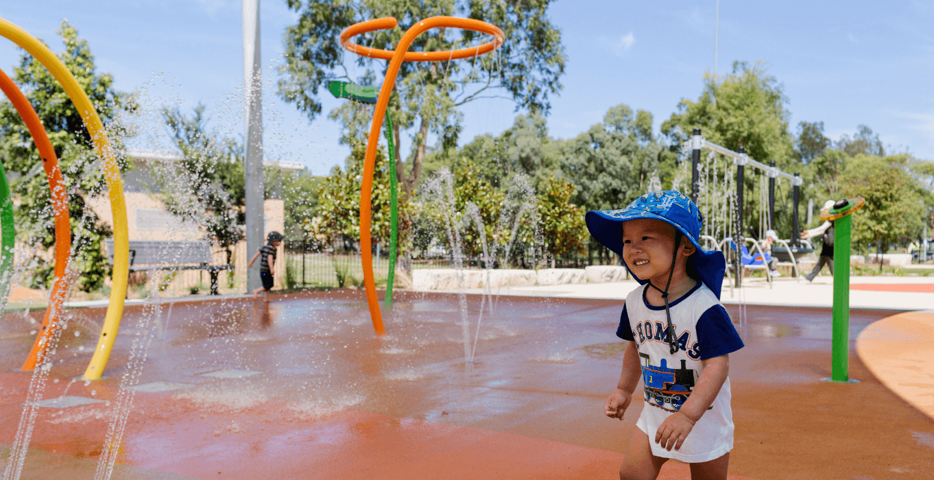 Child smiling in water area