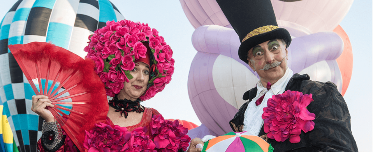 a male and female street theatre performer in fancy dress