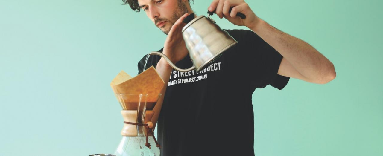 Barista from Darcy Street Project making coffee