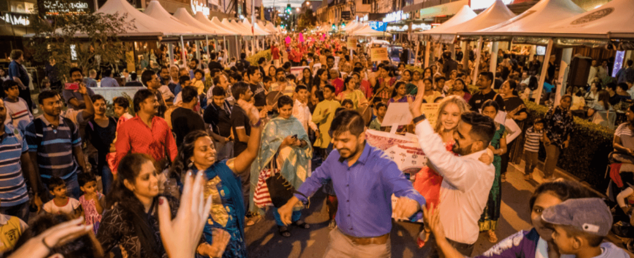 Festival goers dancing on Church Street Parramatta for Parramasala