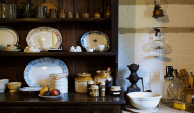 old kitchenware on display cabinet in Hambledon Cottage