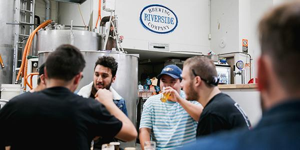A group of men at the Riverside Brewing Company