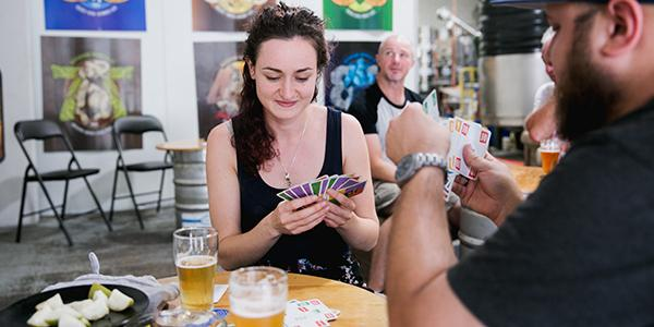 Couple playing cards at the Riverside Brewing Company