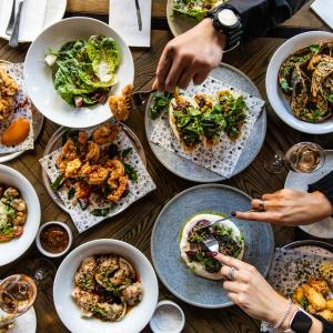 Share table of people eating modern Australian food