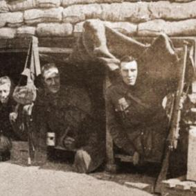 World War One soldiers looking out from bunker