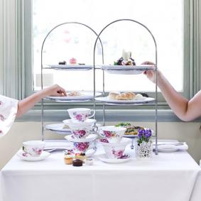 mother and daughter having high tea