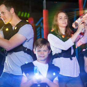 family playing laser tag