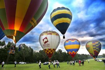 five colourful hot air balloons in Parramatta Park
