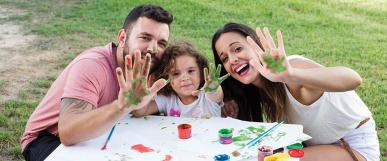 Mum, Dad and Child playing with hand painting