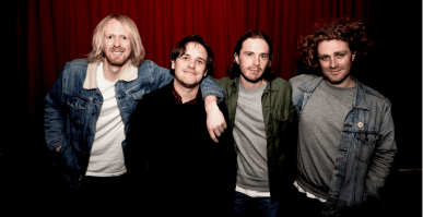 4 male members of the Australian band British India standing in a row