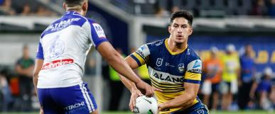 Eels' Dylan Brown with ball against Bulldog player