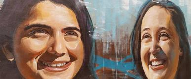 graffiti art of two women's faces