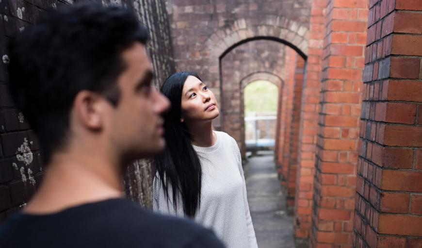 Two people looking at an historical building in Parramatta